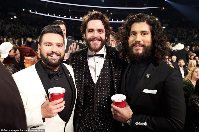 Dan + Shay + Thomas: Shay Mooney, Thomas Rhett and Dan Symers enjoy beverages at the CMAs