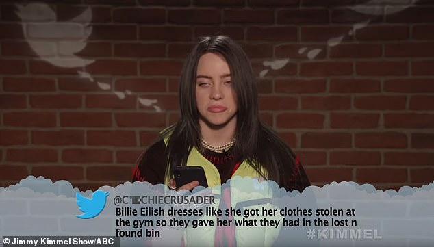 The 17- year-old frowning pop sensation read: 'Billie Eilish dresses like she got her clothes stolen at the gym so they gave her what they had in the lost n found bin'