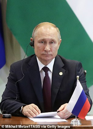 Not wrong! At that, frontman Billie Joe Armstrong hilariously pointed out how much bassist Mike Dirnt resembles Russian President Vladimir Putin (pictured Thursday)