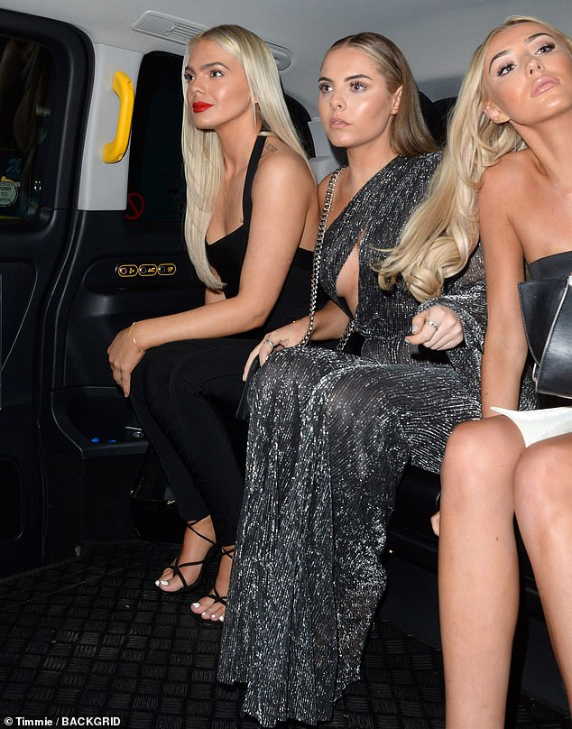 Ready for home: The X Factor star Louisa Johnson climbed into the rear of a cab with two female pals as she prepared to leave the event on Thursday evening