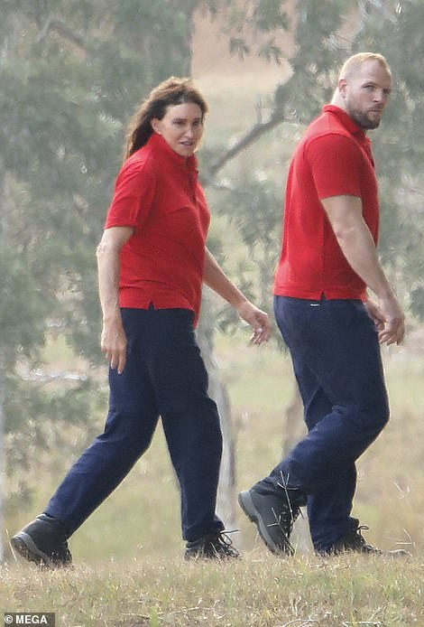 Team mates: The American TV personality was joined by her team mate James, who was dressed in the same red and blue ensemble as he prepared to take to the skies alongside Caitlyn