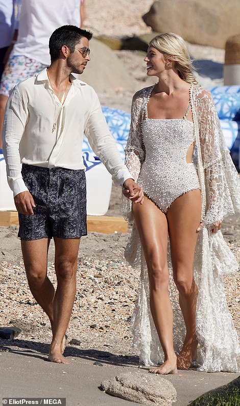 Soon to be married! Devon Windsor and her longtime beau Johnny Dex Barbara couldn't resist packing on the PDA as they frolicked on the beach in St Barts ahead of their hotly-anticipated nuptials