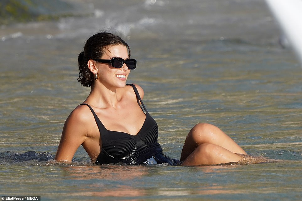 Fun times: Georgia Fowler was also seen making the most of her sensational sunshine as she made her way into the ocean