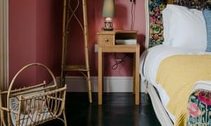 A rhubarb bedroom with dark gloss floors.