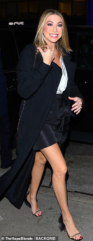Getting a leg up: The Bravo personality was all smiles as she arrived in a black miniskirt which displayed her stellar stems