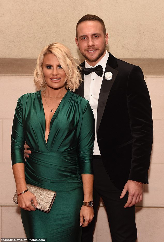 Cute: The former TOWIE star, 31, looked smitten as she embraced her handsome new man while revealing her small bump in a gorgeous emerald gown