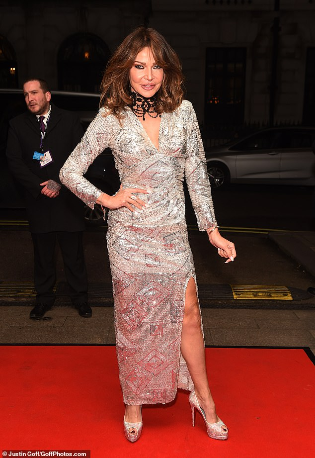 Glitz and glam: Elsewhere, Lizzie Cundy, 49, was her usual glamorous self in a showstopping silver gown