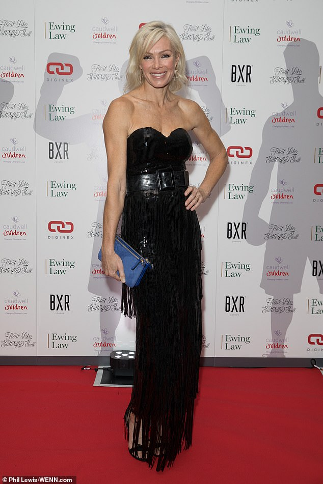 Lovely: Nell McAndrew meanwhile drew the eye in a black strapless gown which had an elaborate sequinned tassel skirt