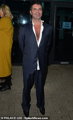 Sharp: The X Factor judge completed the look by wearing a pair of baggy suit trousers, and stepped out in smart black shoes