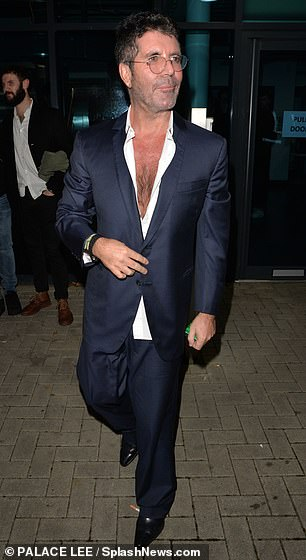 Loose fitting: Despite losing so much weight, Simon continued to wear his signature baggy ensembles for the filming