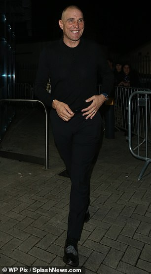 Dapper: Keeping things casual, the actor teamed a long-sleeved black top with matching jeans and tweed-print shoes