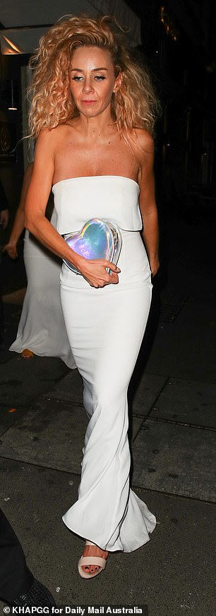 Pretty: The MAFS star wore her signature blonde curls down around her shoulders and opted for an off-the-shoulder white frock