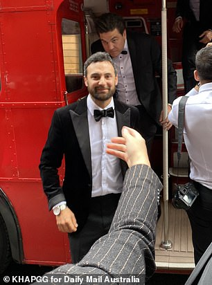 Friends in tow: The vintage British bus was carrying guests and wedding party members