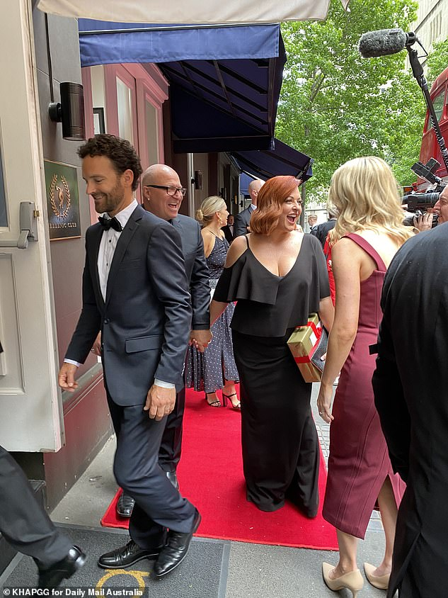 Loving it: Shelly Horton was in attendance with her husband Darren on her arm, both appearing animated on the red carpet leading to the wedding venue