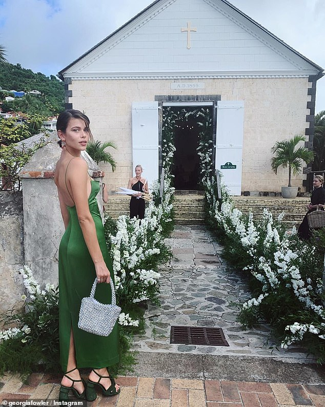 Wedding bells: For the occasion, Georgia slipped her figure into a stunning green silk dress