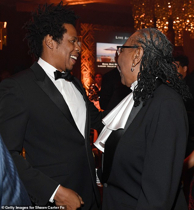 Meanwhile: Jay-Z could be seen mingling among his guests and at one point enjoying a cheerful conversation with his mother Gloria Carter