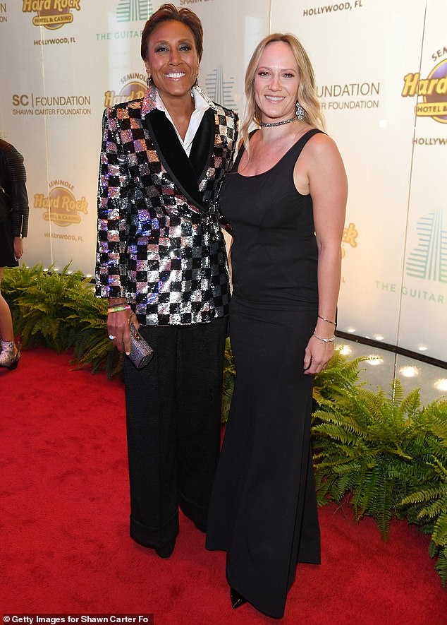 Glowing: News anchor Robin Roberts hit the red carpet that evening with her longtime girlfriend Amber Laign, who modeled a floor-length black gown