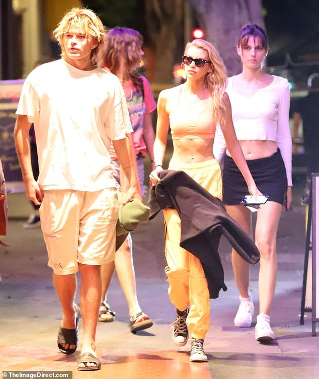 All together: The 29-year-old beauty ensured all attention was on her washboard abs while joined by models, bad boy, Jordan Barrett, Andreja Pejic and Jessica Clarke in Los Angeles