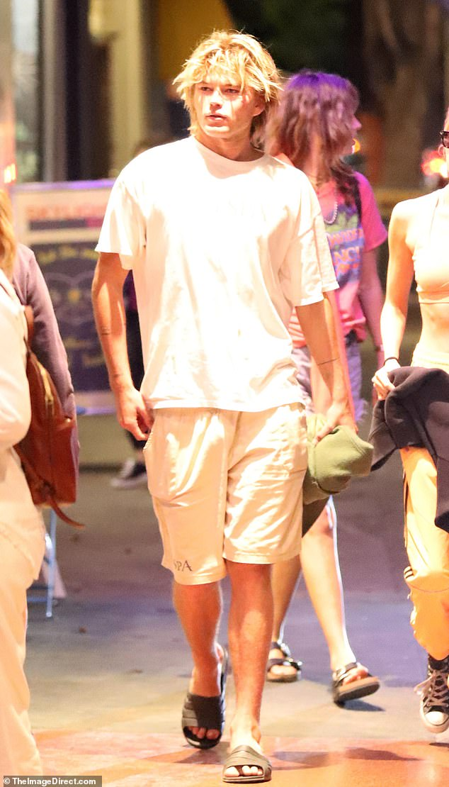Casual: Model bad-boy, Jordan Barrett, 22, was also spotted with the group. He opted for an oversized white T-shirt, board shorts and slides