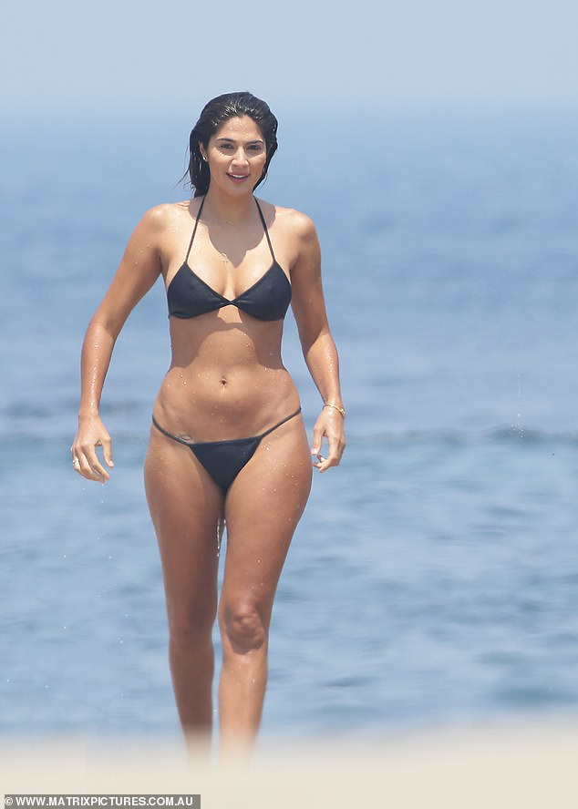 Bond Girl moment! She later stepped out of the water, putting curvy figure on show