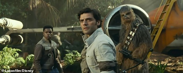Now on a leafier planet: from left are Finn, Poe and Chewbacca outside their spacecraft