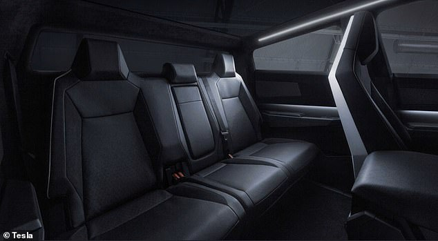 The back passenger seats of the cybertruck are seen after the electric pickup's unveiling