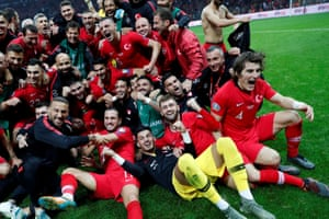 The Turkey players and staff celebrate reaching Euro 2020 after their draw against Iceland.