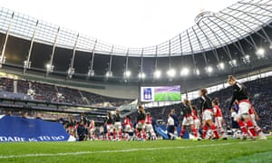 The players make their way onto the pitch.