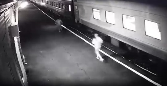 Pic shows: Woman lost her foot while rushing to get into a train. This is the moment a 35-year-old woman loses her foot when she tries to jump onto a moving train and falls onto the tracks.