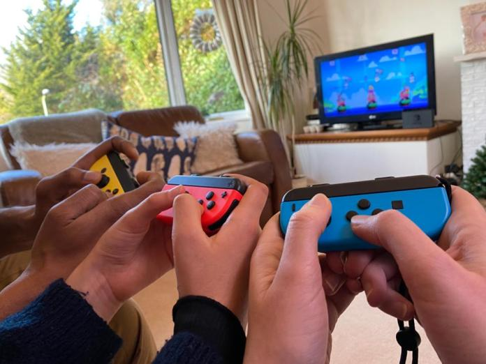 Family Plays Nintendo Switch Game