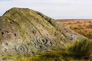 Cup and ring marks on the ancient Badger Stone on Ilkley Moor, Yorkshire, UK.