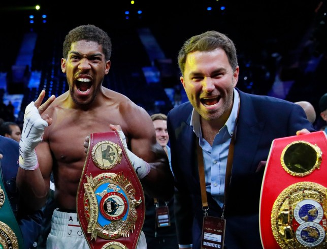 Anthony Joshua and Eddie Hearn celebrate after AJ won back his world heavyweight tiltes