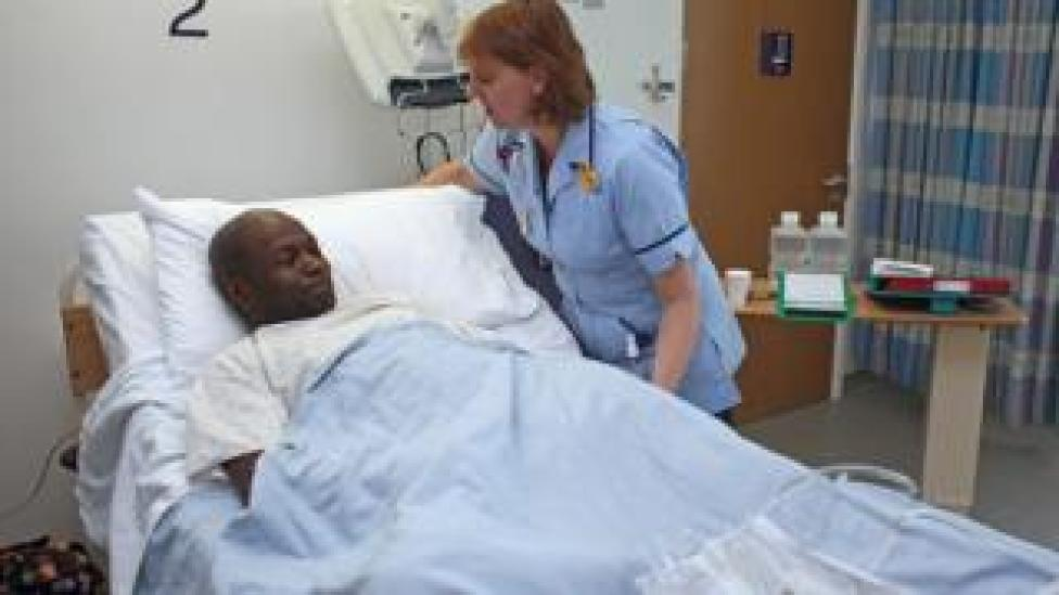 NHS patient in a bed