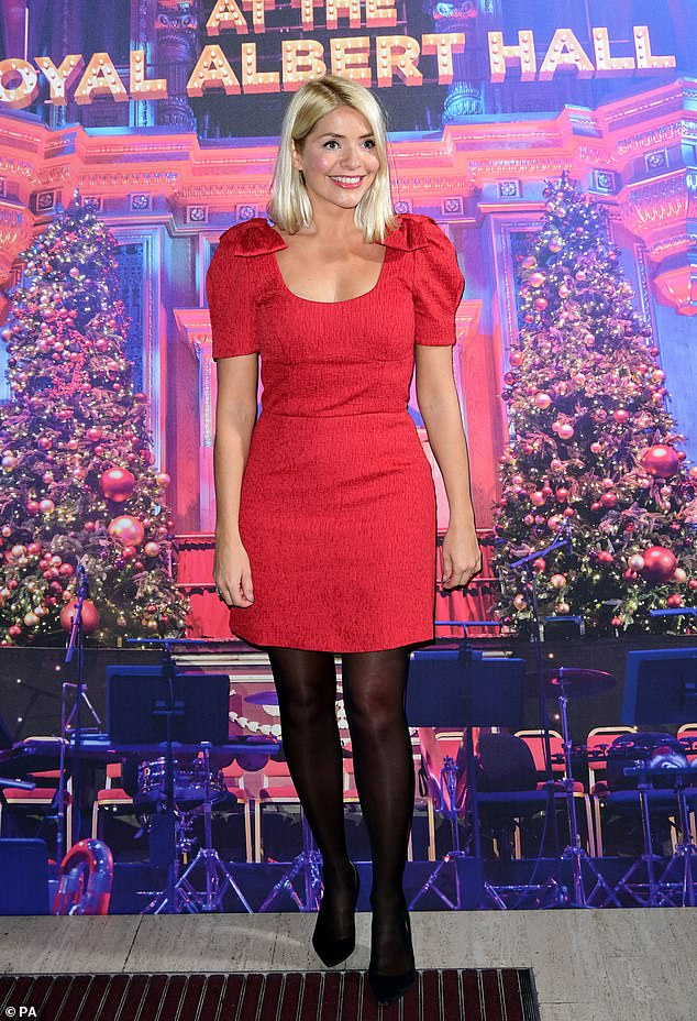 Festive bash: Holly Willoughby was leading the arrivals at Emma Bunton's star-studded Christmas Party, held at the Royal Albert Hall in London on Friday night