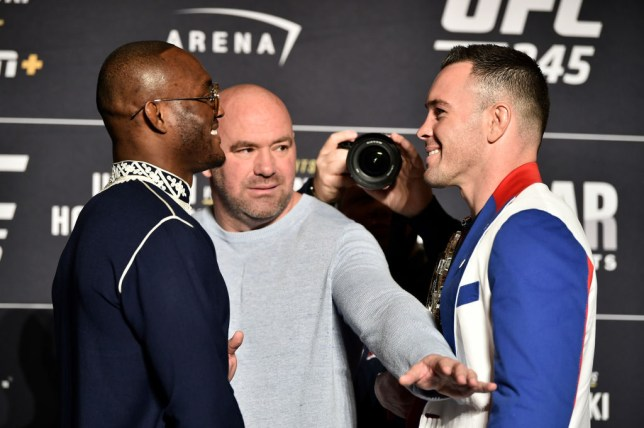 Kamaru Usman and Colby Covington both grin during their face-off ahead of their UFC fight