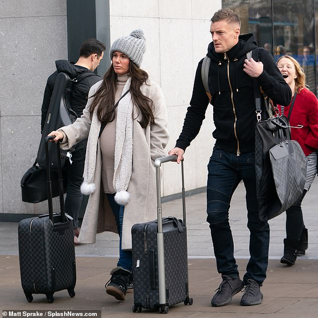 Bumping along:Rebekah Vardy was shirking her woes on Thursday as she arrived at London King Cross alongside her husband Jamie before heading to an awards ceremony