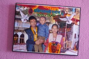 Nirmala Pakrin with her husband and son Niraj.