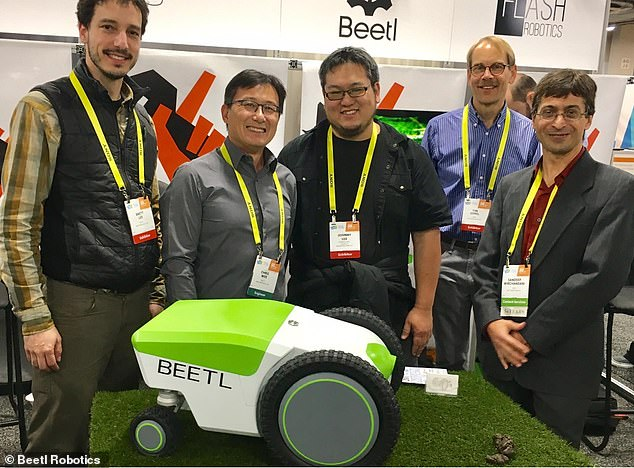 The technology is still in the testing phase, so until it is ready for market, pet owners will have to scoop up after their pets (Pictured is the team that designed and invested the Beetl)