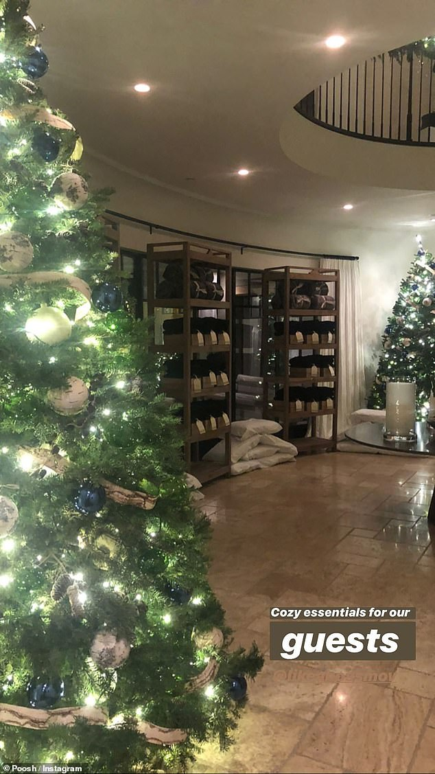 A lovely display: Her foyer had big Christmas trees and was packed with gifts