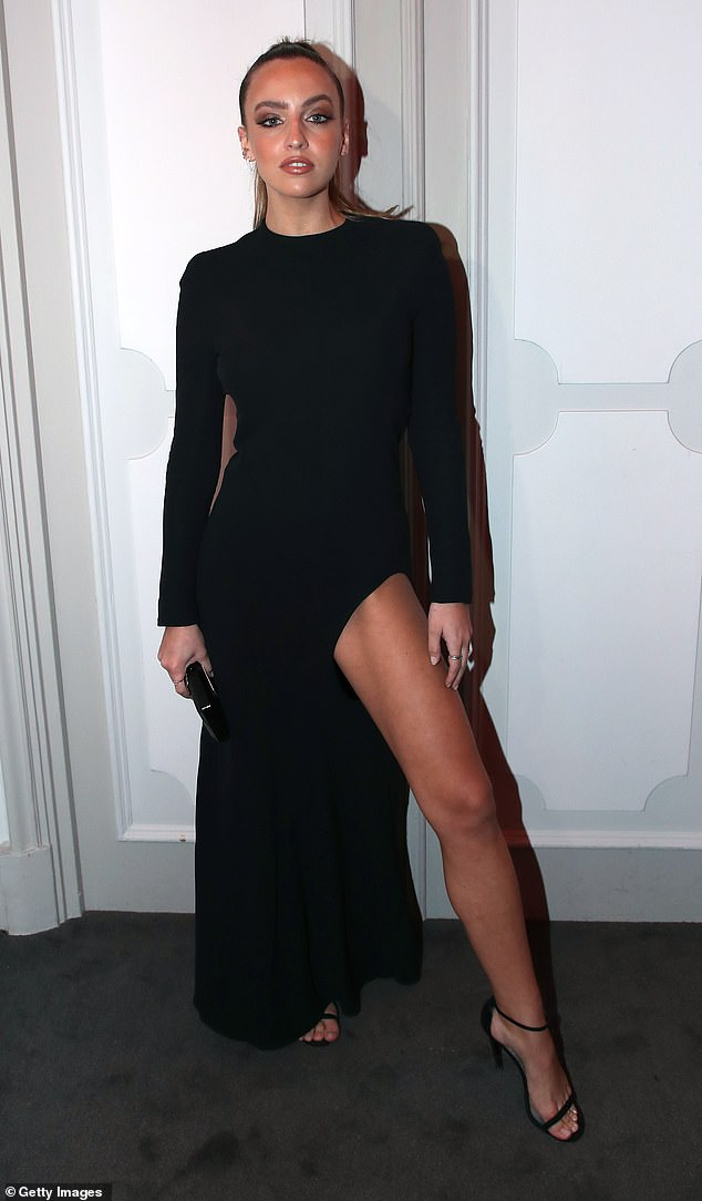 Model: Carla Ginola, 25, looked radiant as ever in a black long-sleeved dress with a leg slit