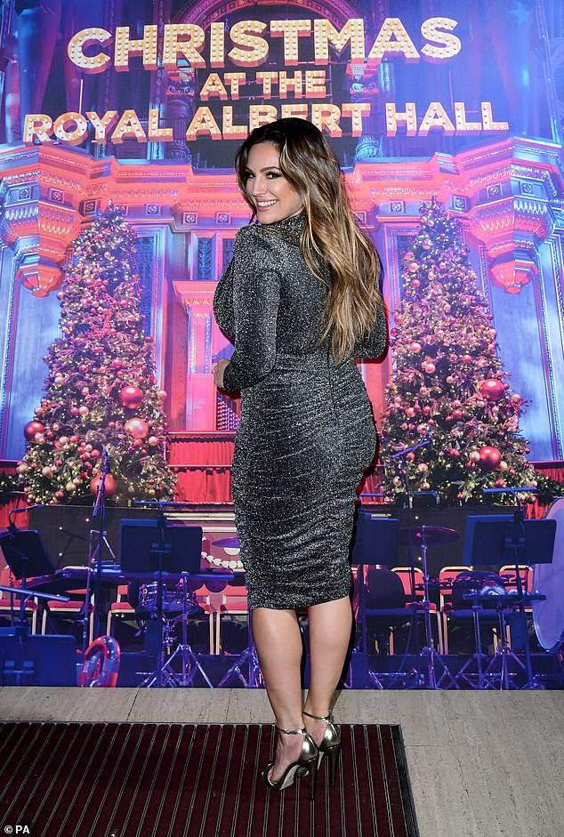 Beauty: Kelly styled her long, ombre locks in waves, casting a sultry look over one shoulder