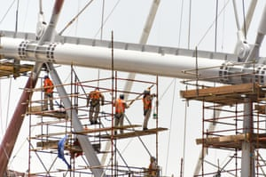 Workers at the Khalifa Stadium in Doha