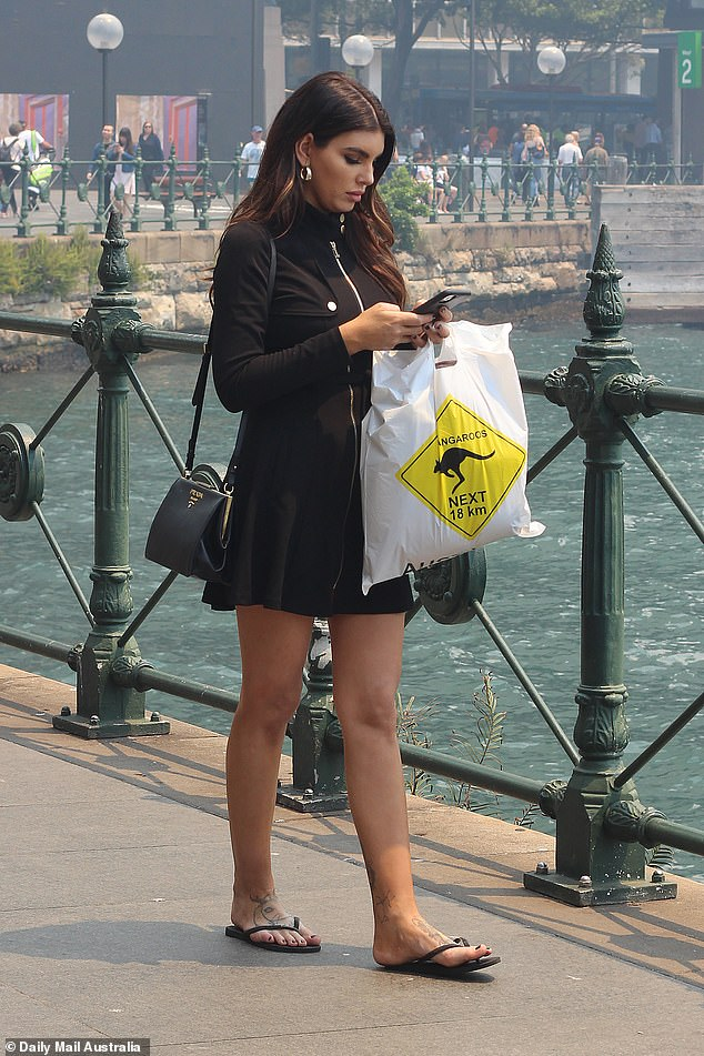 Tourist:Meanwhile, Nicole, who boasts 1.1 million followers on Instagram, wore a black long-sleeved mini dress, which she accessorised with a Prada bag