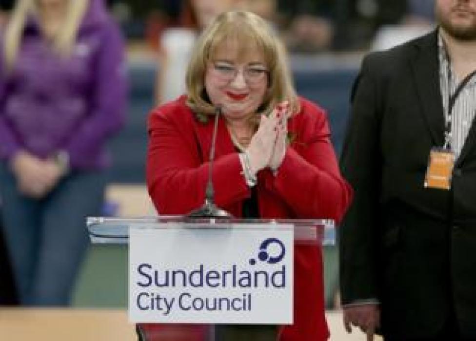 Sharon Hodgson reacts with joy