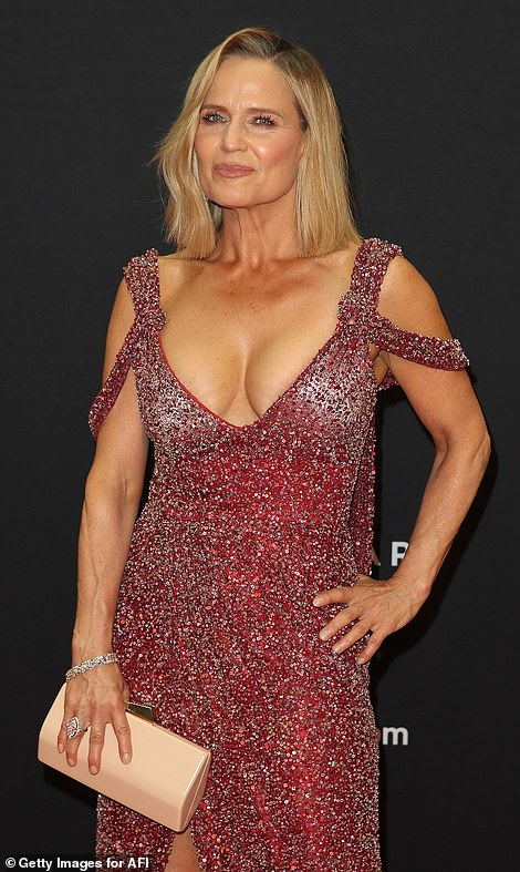 Busting out: The 56-year-old Block judge opted for a daring dress, which showed off her ample cleavage