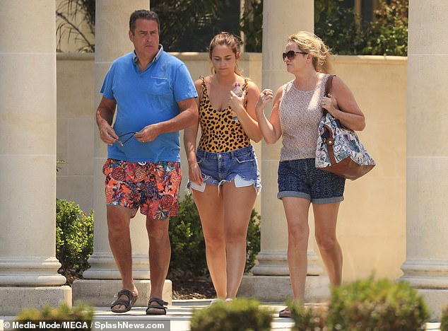 Outing:The former EastEnders star cut a stylish figure for the outing, donning a leopard print swimsuit and a pair of blue denim hotpants
