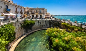 Southern comforts: escape the snow and ice with a long train ride across Europe ending it Siracuse in Sicily.