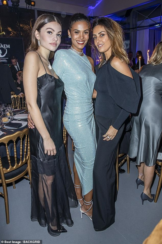 Stylish: Thylanelooked stunning as she posed for a snap with Tina and another female pal