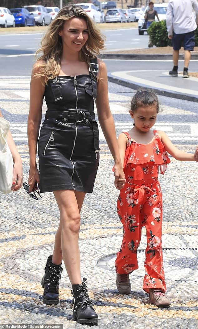 Inseparable:Nadine, 34, looked stylish in a black belted minidress while walking hand in hand with her daughter outside the luxurious Palazzo Versace Gold Coast following the conclusion of this year's I'm A Celebrity... Get Me Out Of Here!
