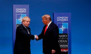 Boris Johnson shaking hands with Donald Trump.